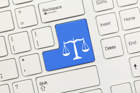 Close-up view on white conceptual keyboard - Law symbol (blue key)